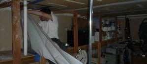 Disaster Restoration Tech Installing Vapor Barrier