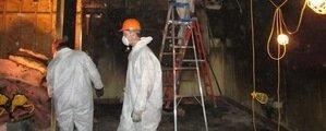 Technicians Restoring A Local Business After A Hurricane