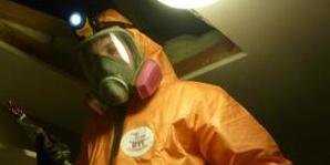 Mold Removal Heathrow Experts in Hazmat suit